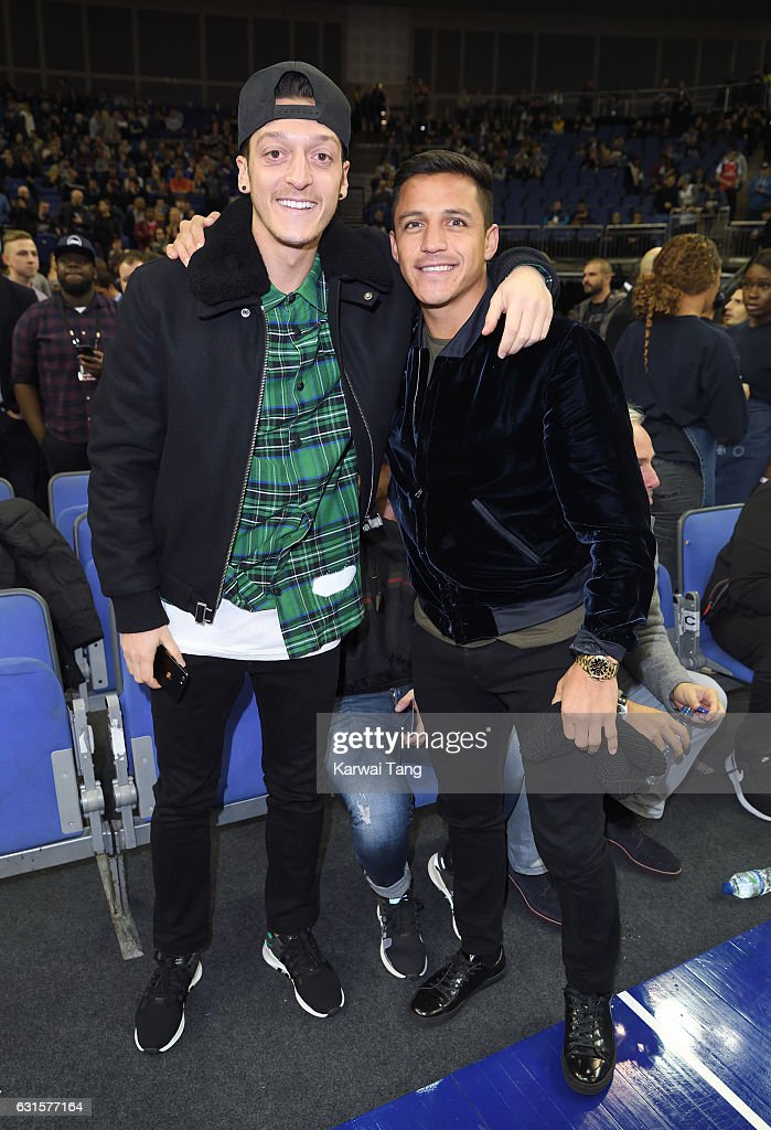 Mesut Ozil and Alexis Sanchez attend the Denver Nuggets v Indiana Pacers match as part of the NBA Global Games London 2017 at The O2 Arena on January 12, 2017 in London, England.