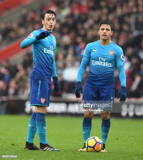 Mesut Ozil and Alexis Sanchez during the Premier League match between Southampton and Arsenal at St Mary's Stadium on December 10 2017 in Southampton...