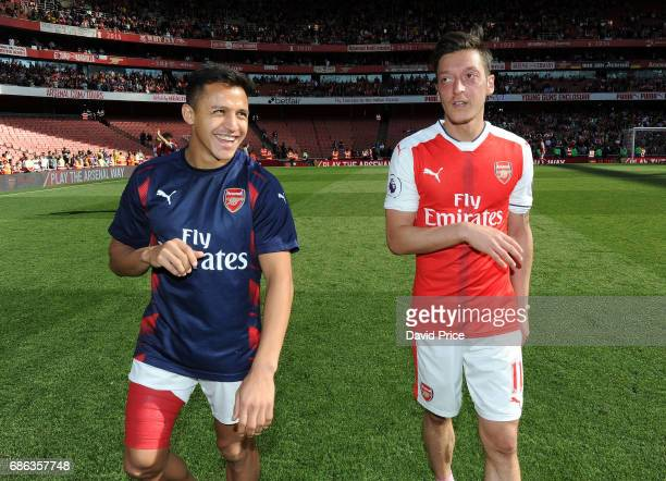Mesut Ozil and Alexis Sanchez of Arsenal after the Premier League match between Arsenal and Everton at Emirates Stadium on May 21 2017 in London...