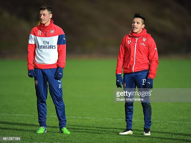 Mesut Ozil and Alexis Sanchez of Arsenal during a training session at London Colney on January 10 2015 in St Albans England