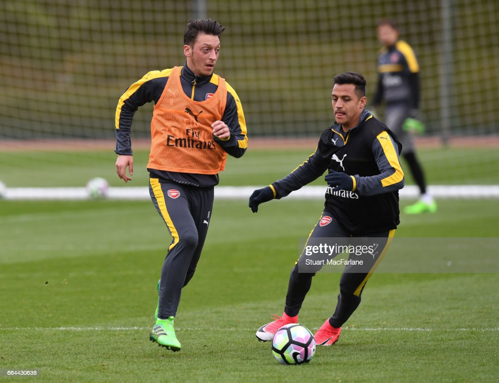 Mesut Ozil and Alexis Sanchez of Arsenal during a training session at London Colney on April 4, 2017 in St Albans, England.