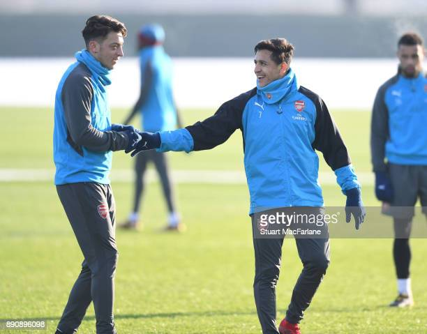 Mesut Ozil and Alexis Sanchez of Arsenal during a training session at London Colney on December 12 2017 in St Albans England