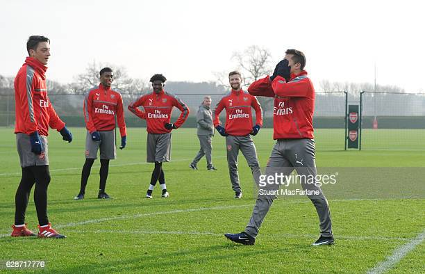 Mesut Ozil and Alexis Sanchez of Arsenal joke around during a training session at London Colney on December 9 2016 in St Albans England
