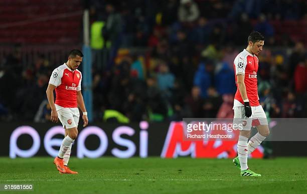 Mesut Ozil and Alexis Sanchez of Arsenal leave the pitch at the half time during the UEFA Champions League round of 16 second Leg match between FC...