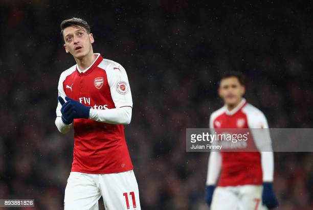 Mesut Ozil and Alexis Sanchez of Arsenal look on during the Premier League match between Arsenal and Newcastle United at Emirates Stadium on December...