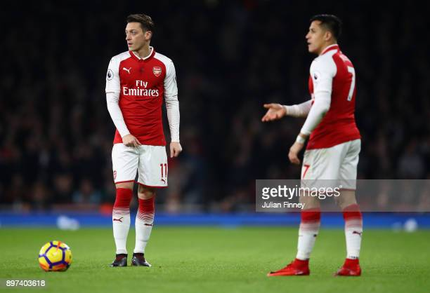 Mesut Ozil and Alexis Sanchez of Arsenal prepare a free kick during the Premier League match between Arsenal and Liverpool at Emirates Stadium on...