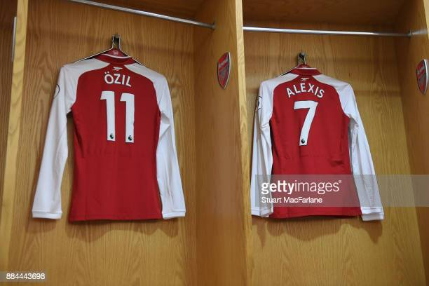 Mesut Ozil and Alexis Sanchez's shirt hang in the Arsenal changing room before the Premier League match between Arsenal and Manchester United at...