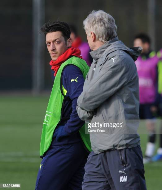Mesut Ozil and Arsene Wenger the Arsenal Manager during the Arsenal Training Session at London Colney on February 14, 2017 in St Albans, England.