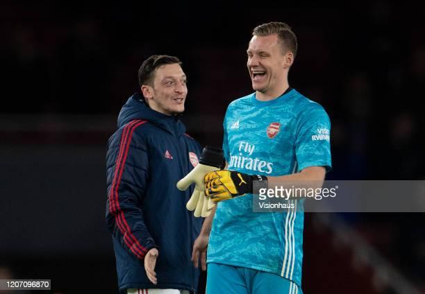 Mesut Ozil and Bernd Leno of Arsenal FC celebrate winning the Premier League match between Arsenal FC and Newcastle United at Emirates Stadium on...