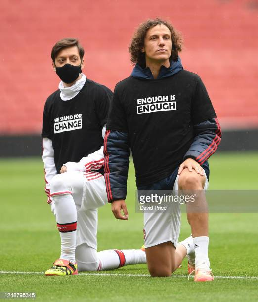 Mesut Ozil and David Luiz of Arsenal take a knee in support of Black Lives Matter before the friendly match between Arsenal and Brentford at Emirates...