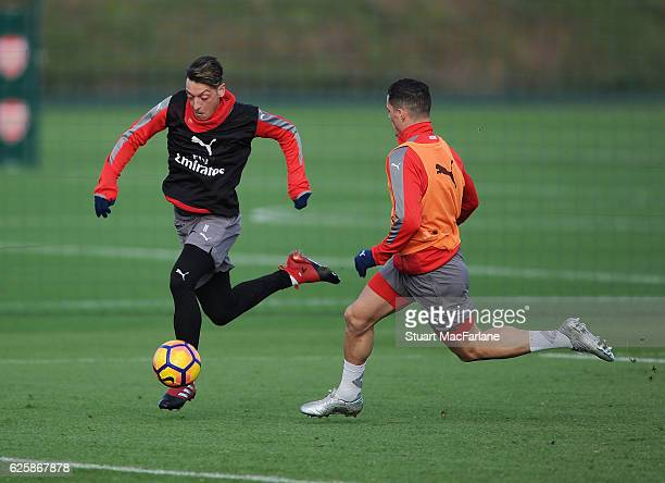 Mesut Ozil and Granit Xhaka of Arsenal during a training session in preparation for the Premier League match against AFC Bournemouth at London Colney...