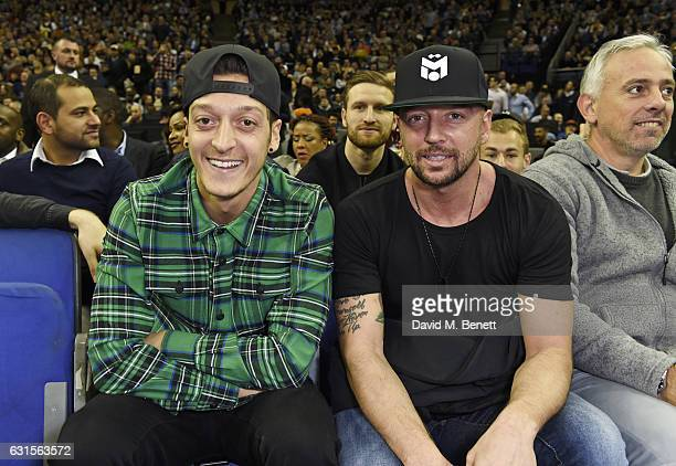 Mesut Ozil and guest sit courtside at the NBA Global Game London 2017 basketball game between the Indiana Pacers and Denver Nuggets at The O2 Arena...