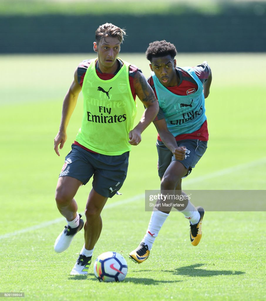 Mesut Ozil and Joe Willock of Arsenal during a training session at London Colney on July 5, 2017 in St Albans, England.