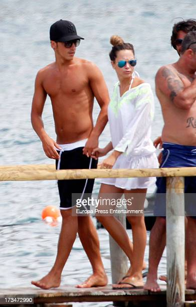 Mesut Ozil and Mandy Capristo are seen on July 12 2013 in Ibiza Spain