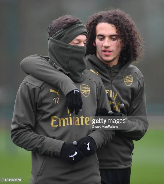 Mesut Ozil and Matteo Guendouzi of Arsenal during a training session at London Colney on January 24 2019 in St Albans England