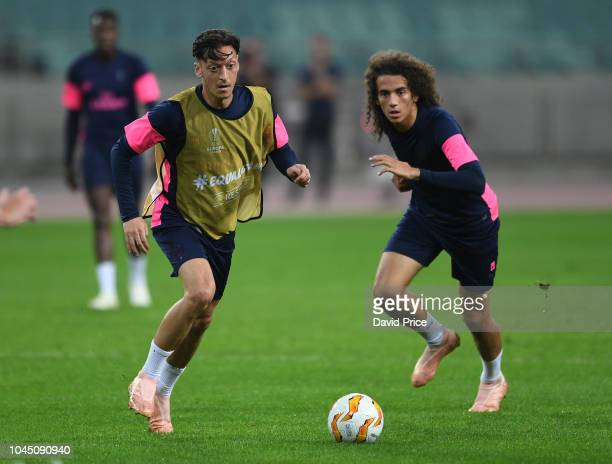 Mesut Ozil and Matteo Guendouzi of Arsenal during the Arsenal training session at Baku Olimpiya Stadionu on October 3 2018 in Baku Azerbaijan