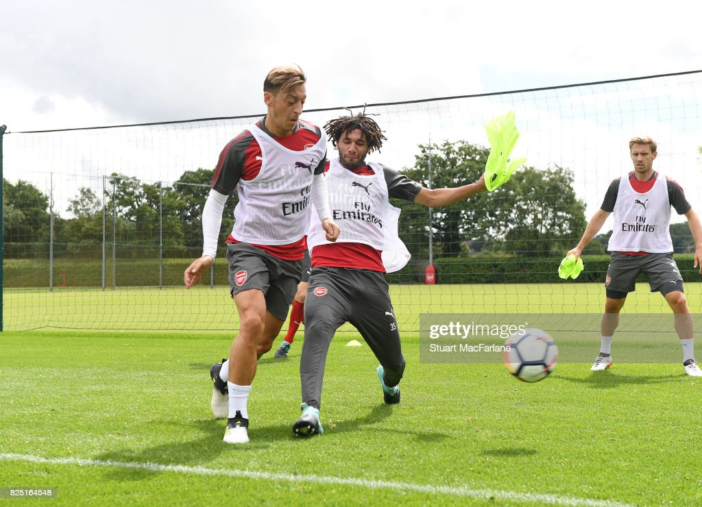Mesut Ozil and Mohamed Elneny of Arsenal during a training session at London Colney on August 1, 2017 in St Albans, England.
