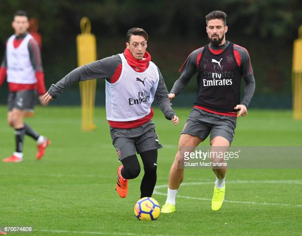Mesut Ozil and Olivier Giroud of Arsenal during a training session at London Colney on November 4 2017 in St Albans England