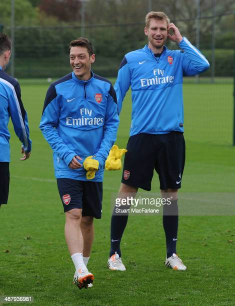 Mesut Ozil and Per Mertesacker of Arsenal during a training session at London Colney on May 3, 2014 in St Albans, England.