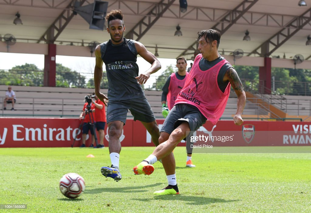 Mesut Ozil and Pierre-Emerick Aubameyang of Arsenal during an Arsenal Training Session at Singapore American School on July 23, 2018 in Singapore.