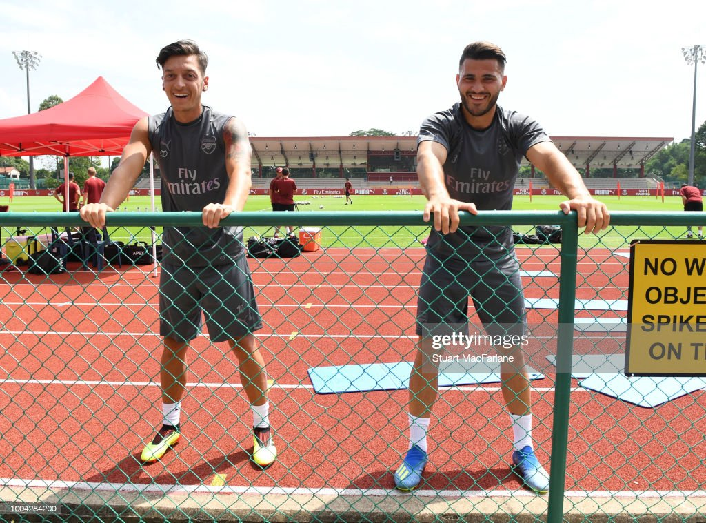 Mesut Ozil and Sead Kolasinac of Arsenal during a training session at Singapore American School on July 23, 2018 in Singapore.