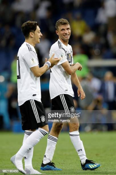 Mesut Ozil and Thomas Muller of Germany celebrate after winning the match at the end of the 2018 FIFA World Cup Russia Group F match between Germany...