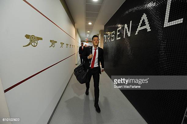 Mesut Ozil arrives in the Arsenal changing room before the Premier League match between Arsenal and Chelsea at Emirates Stadium on September 24 2016...