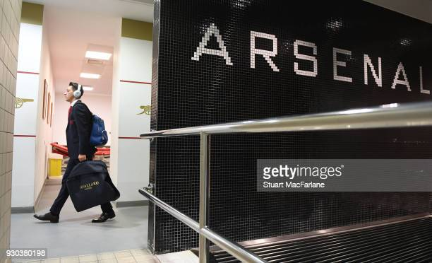 Mesut Ozil arrives in the Arsenal changing room before the Premier League match between Arsenal and Watford at Emirates Stadium on March 10 2018 in...