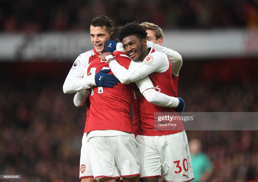 Mesut Ozil celebrates scoring a goal for Arsenal with Granit Xhaka and Ainsley Maitland-Niles during the Premier League match between Arsenal and Newcastle United at Emirates Stadium on December 16, 2017 in London, England.