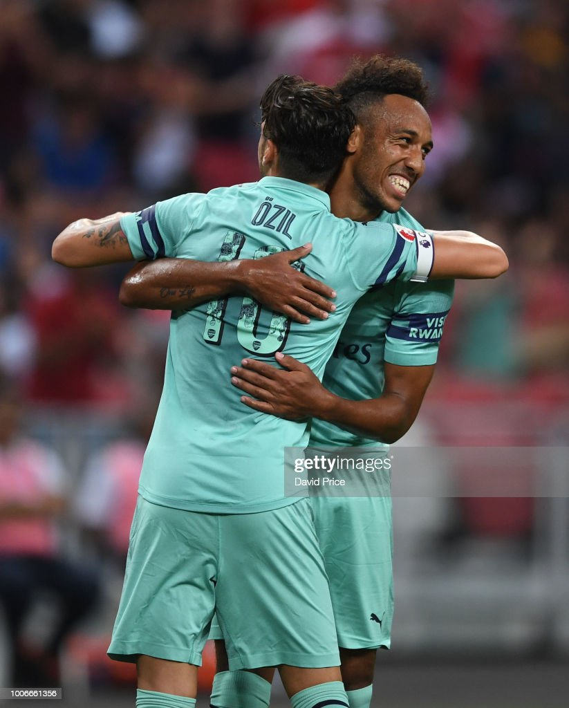 Mesut Ozil celebrates scoring a goal for Arsenal with Pierre-Emerick Aubameyang during the International Champions Cup match between Arsenal and Paris Saint Germain at the National Stadium on July 28, 2018 in Singapore.
