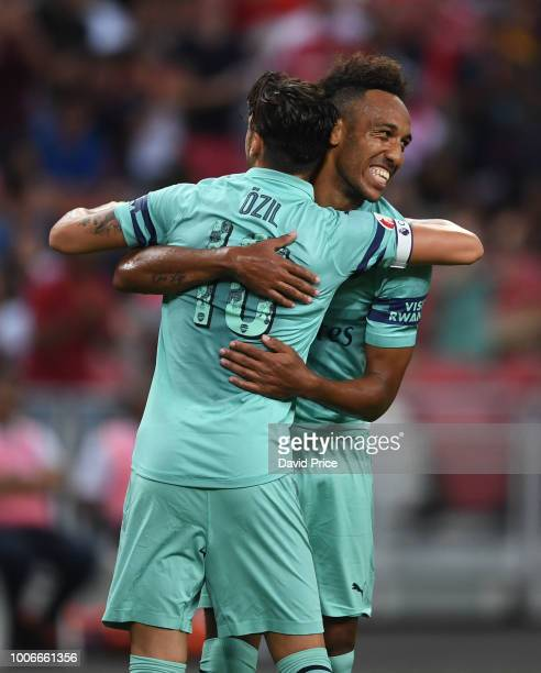 Mesut Ozil celebrates scoring a goal for Arsenal with PierreEmerick Aubameyang during the International Champions Cup match between Arsenal and Paris...