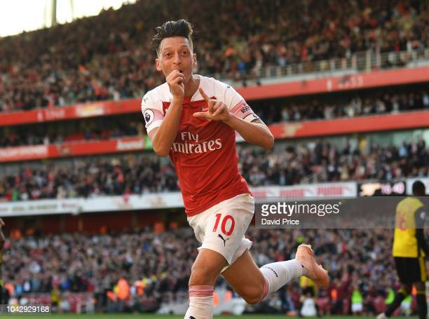Mesut Ozil celebrates scoring Arsenal's 2nd goal during the Premier League match between Arsenal FC and Watford FC at Emirates Stadium on September...