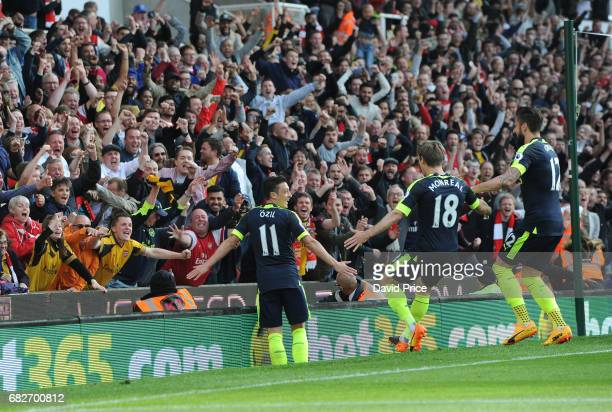 Mesut Ozil celebrates scoring Arsenal's 2nd goal during the Premier League match between Stoke City and Arsenal at Bet365 Stadium on May 13 2017 in...