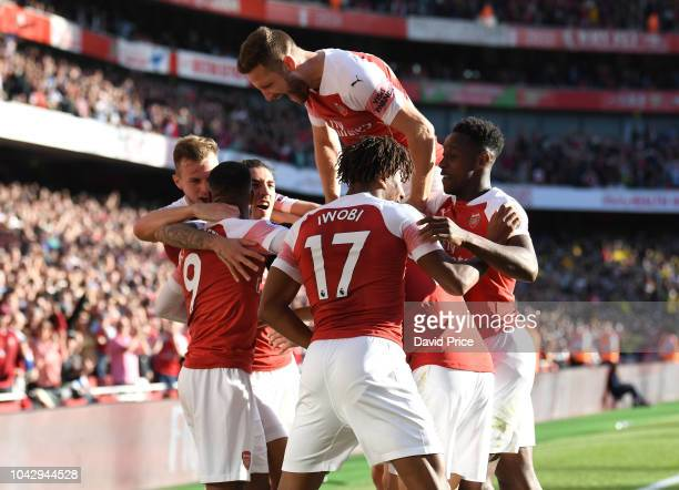 Mesut Ozil celebrates scoring Arsenal's 2nd goal with with his team mates during the Premier League match between Arsenal FC and Watford FC at...