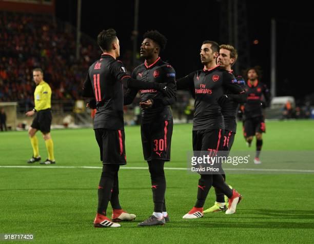 Mesut Ozil celebrates scoring Arsenal's 3rd goal with Ainsley MaitlandNiles and Henrikh Mkhitaryan during UEFA Europa League Round of 32 match...