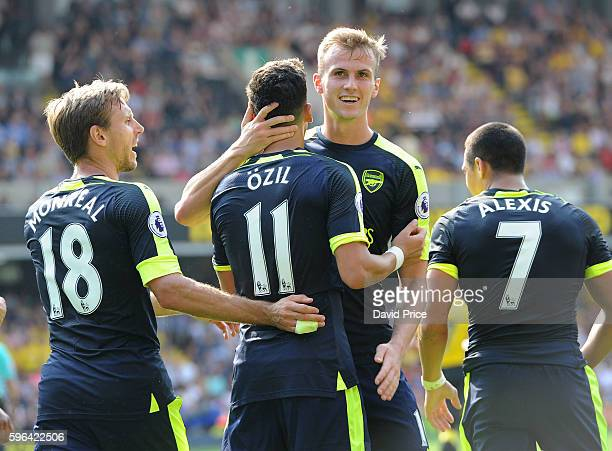 Mesut Ozil celebrates scoring Arsenal's 3rd goal with Rob Holding during the Premier League match between Watford and Arsenal at Vicarage Road on...