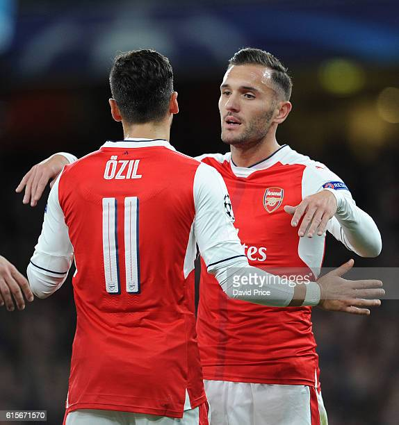 Mesut Ozil celebrates scoring Arsenal's 6th goal his 3rd with Lucas Perez during the UEFA Champions League match between Arsenal FC and PFC...