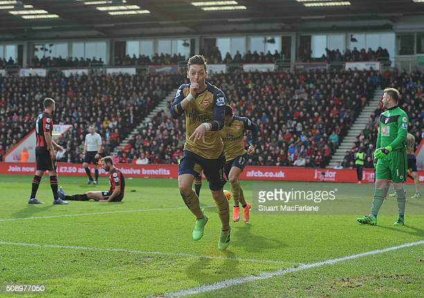 Mesut Ozil celebrates scoring the 1st Arsenal goal during the Barclays Premier League match between AFC Bournemouth and Arsenal at The Vitality...