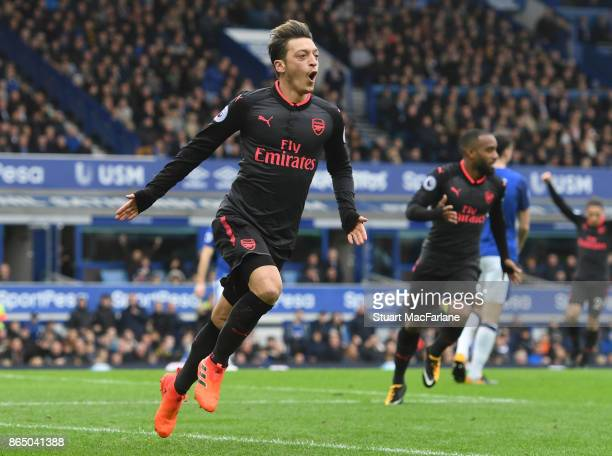 Mesut Ozil celebrates scoring the 2nd Arsenal goal during the Premier League match between Everton and Arsenal at Goodison Park on October 22 2017 in...