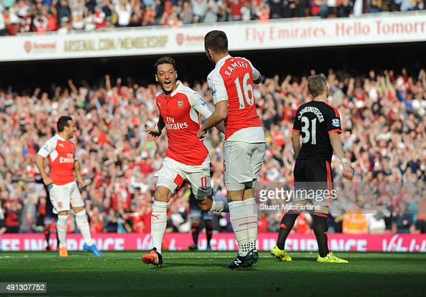 Mesut Ozil celebrates scoring the 2nd Arsenal goal with aaron Ramsey during the Barclays Premier League match between Arsenal and Manchester United...