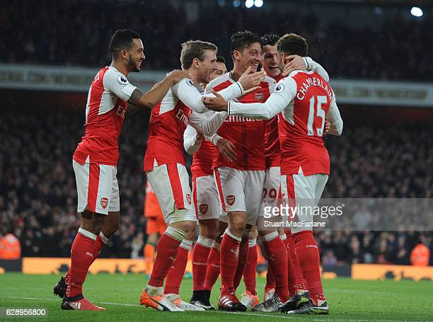 Mesut Ozil celebrates scoring the 2nd Arsenal goal with Alex OxladeChamberlain Theo Walcott and Nacho Monreal during the Premier League match between...