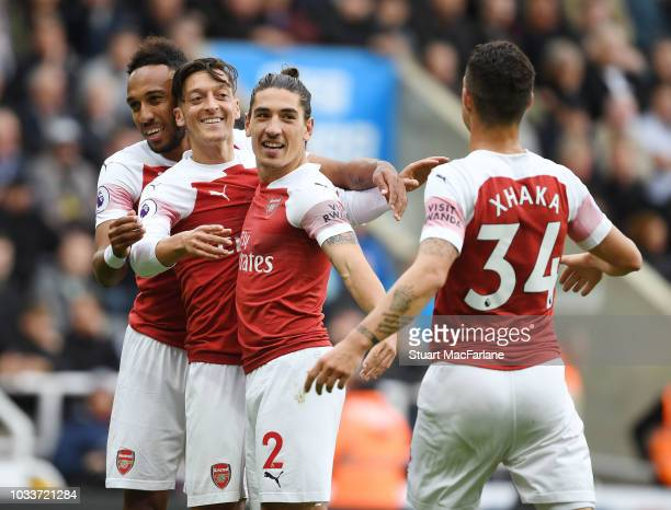 Mesut Ozil celebrates scoring the 2nd Arsenal goal with PierreEmerick Aubameyang Hector Bellerin and Granit Xhaka during the Premier League match...