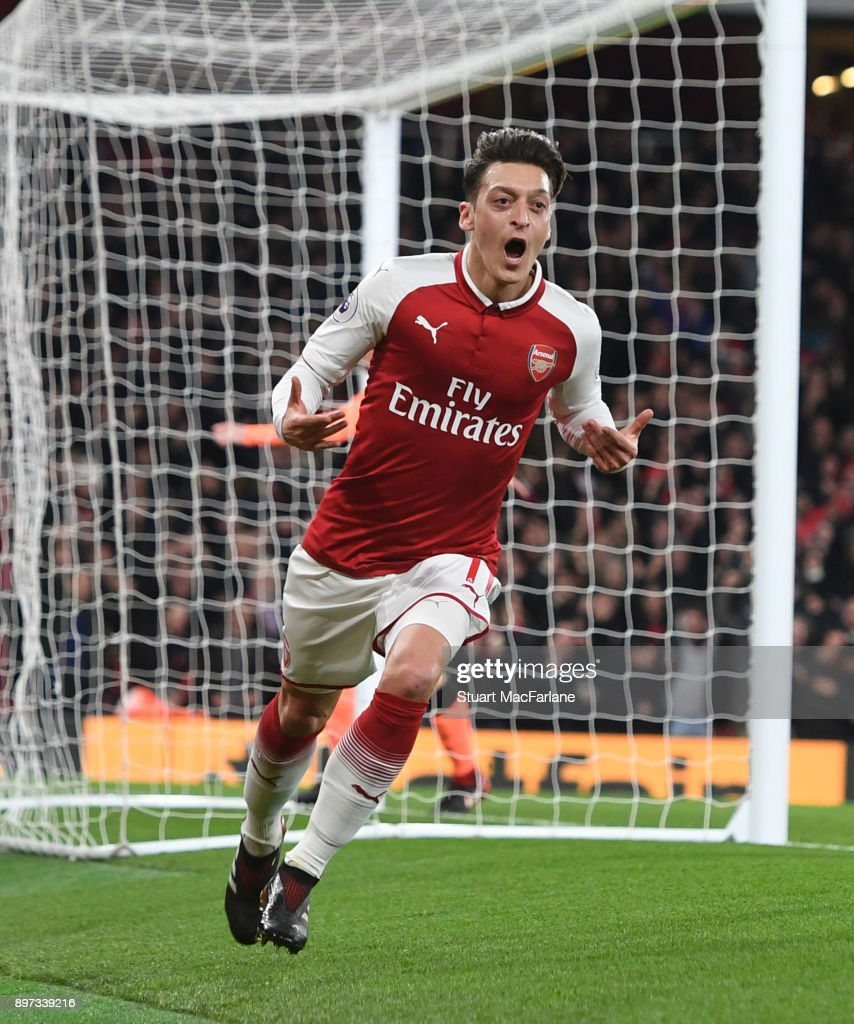 Mesut Ozil celebrates scoring the 3rd Arsenal goal during the Premier League match between Arsenal and Liverpool at Emirates Stadium on December 22, 2017 in London, England.