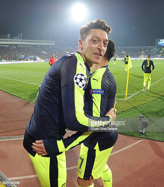 Mesut Ozil celebrates scoring the 3rd Arsenal goal with Alexis Sanchez during the UEFA Champions League match between PFC Ludogorets Razgrad and...