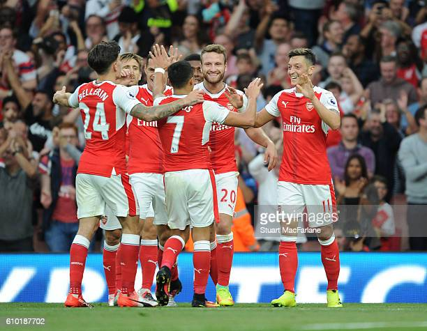 Mesut Ozil celebrates scoring the 3rd Arsenal goal with Hector Bellerin Alexis Sanhez and Shkodran Mustafi during the Premier League match between...
