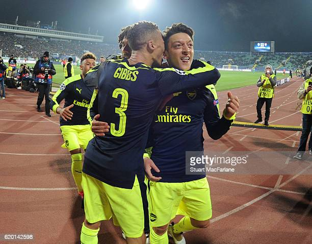 Mesut Ozil celebrates scoring the 3rd Arsenal goal with Kieran Gibbs during the UEFA Champions League match between PFC Ludogorets Razgrad and...