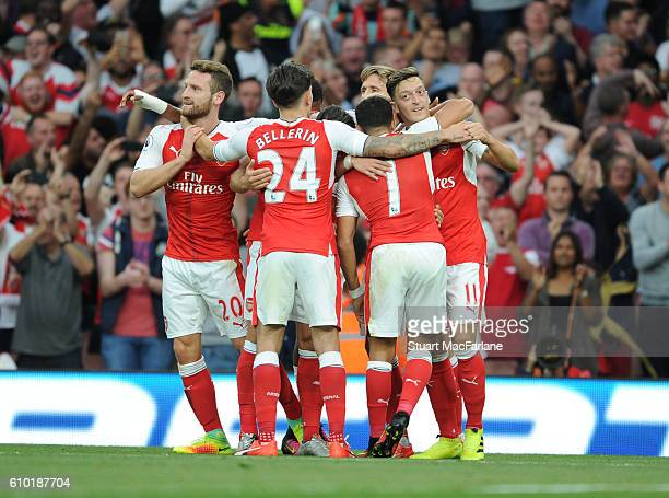Mesut Ozil celebrates scoring the 3rd Arsenal goal with Shkodran Mustaf Hector Bellerin Alexis Sanhez during the Premier League match between Arsenal...