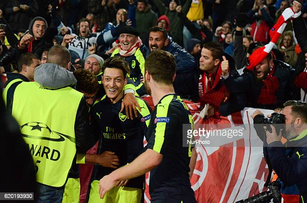 Mesut Ozil celebrating with Arsenal fans after scores a goal during theUEFA Champions League Group A football match between PFC Ludogorets 23 Arsenal...