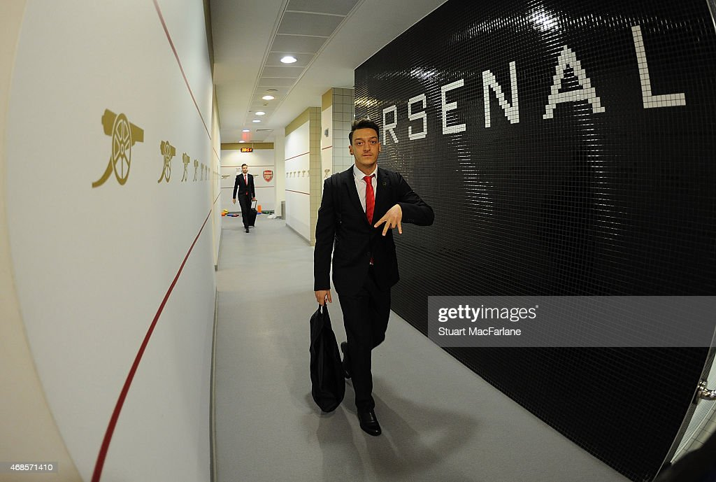 Mesut Ozil enters the Arsenal changing room before the Barclays Premier League match between Arsenal and Liverpool at Emirates Stadium on April 4, 2015 in London, England. Photo by Stuart MacFarlane/Arsenal FC via Getty Images)
