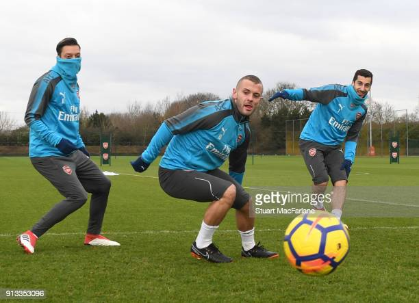 Mesut Ozil Jack Wilshere and Henrikh Mkhitaryan of Arsenal during a training session at London Colney on February 2 2018 in St Albans England